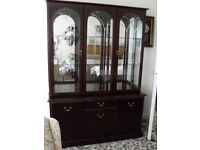 Dark Wood Glass Display Cabinet. Inner Mirrors and Lights. Cupboard and Drawer Front.