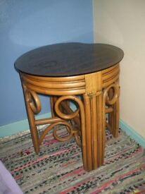 Cane table with glass top in very good condition. Open to offers. Can deliver at buyers expense