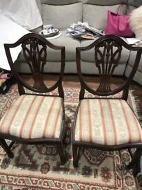 Solid mahogany dining table and 10 chairs. Would make a great uocycling project!