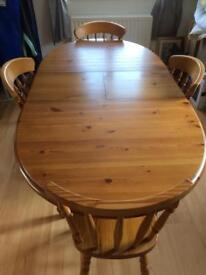 Extending pine dining table & chairs