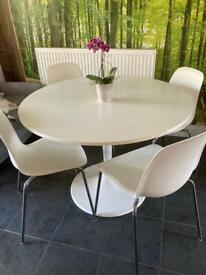 TABLE AND 4 CHAIRS SET. LOVELY MODERN. EASY CLEAN