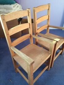 Pair of solid pine carver chairs