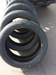 LIKE NEW ULTRA HIGH PERFORMANCE CONTINENTAL WINTER TIRE 235 / 45 / 19 SET OF FOUR. NO RIMS.