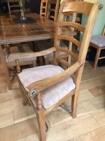 Dining table with 2 carvers and 6 chairs. Solid wood with marble insets. In excellent condition.