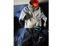Superdry jacket with salopettes and ski goggles