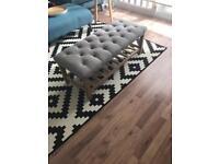 Upholstered footstool/ottoman with oak shelf storage