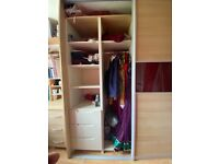 Double set of sliding door wardrobes with insert drawers