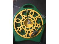 Flat hose reel for camping
