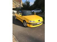 Yellow convertible Peugeot 306 cabriolet