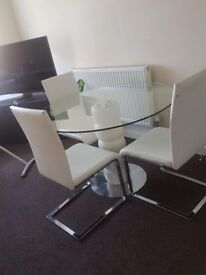 Glass table with 4 white chairs