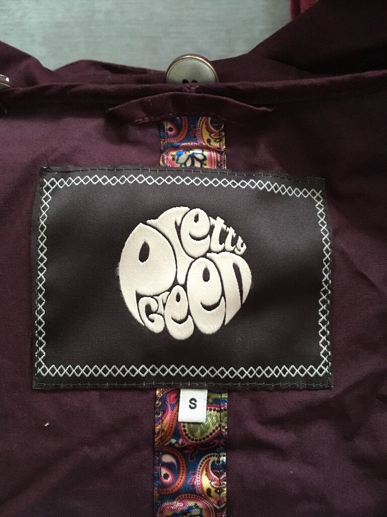 Pretty Green Small Jacketin Stanley, County DurhamGumtree - Small unisex Pretty Green jacket in burgundy. Paisley silk strip down the inside of the jacket. Brown leather badge on the left breast and cuffed sleeves on either arm. Silk inner hood can be removed. Spare button still bagged on the inside. Bought...