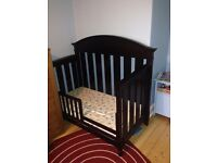 lovely walnut brown cot + toddler bed for sale