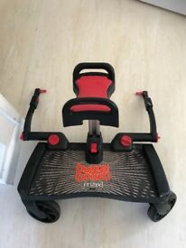 Buggy board with folding seat