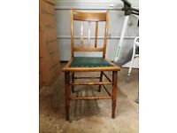 Set of 2 wooden dining chairs with studded leather cushioned seats.