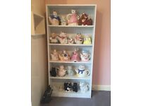 Collection of 23 cat teapots together with display cabinet