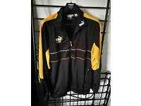 Awesome Puma King retro vintage track top Black and Amber