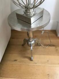 A pair of Silver metal side tables, beautiful