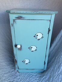 Vintage bedside/storage cabinet.