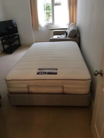 Nearly new small double adjustable (electric) bed and matress.