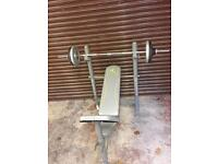 Weight training bench and cast iron weights