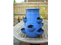 Blue Shiny Ceramic Strawberry Planter in good condition with no visible damage.