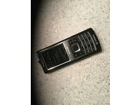Nokia 6500 classic mobile phone with booklet, disc and charger