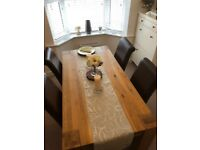 Solid rustic oak table and chairs