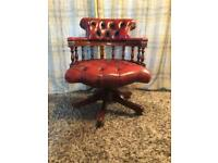 Gorgeous oxblood red leather captains chair