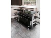 Black TV stand with chrome colour legs
