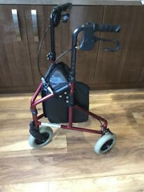 3 wheel walking aid with bag.