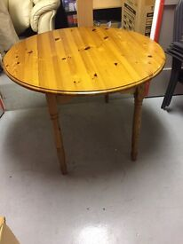Solid wood dining table with four chairs. Very good condition. Buyer collects.