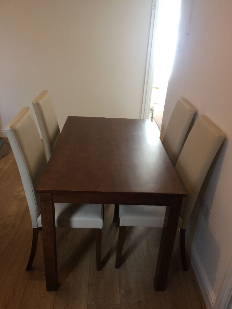 Dining table and 4 chairsin Roath, CardiffGumtree - Dining table and 4 chairs. Wooden dining table and 4 cream chairs with wooden legs. Lovely set in good condition with light wear. Sold as seen. Table measures 120cm long x 75cm wide x 74cm high. £95 but will consider offers, especially if can be...