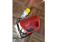 MILWAUKEE M12 Red Lithium Ion Battery Charger (only) 12 Volt 48-59-2401 USED one 110 volt site plug