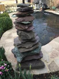 Rock feature, holes in centre of each rock for garden/koi fish pond