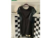 Black mini dress with leather panels and low cut zip back