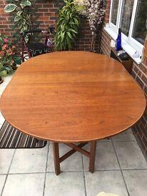 Oval gate leg drop leaf table. Teak seats 6. Collect
