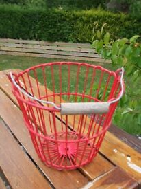 vintage egg collecting red basket with wooden handle