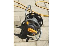 Used perfect working hose and reel