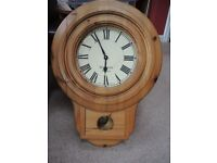 Reproduction Victorian school/station clock, wall mounted pendulum in antique pine