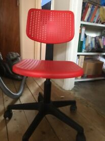 Red adjustable chair on wheels