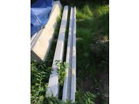 Concrete fence posts and gravel board