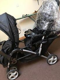 Double pushchair with rain cover
