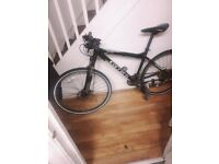 Carrera hybrid bike going for a good price! Not specialized giant trek