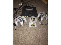Nintendo 64 with 2 controllers and 2 games