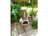 Heavy quality clay/ terracotta wood burning chiminea with metal stand, great condition