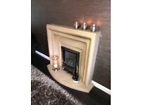 Stone fire surround and gas fire