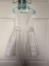 Two cream flower girls dresses