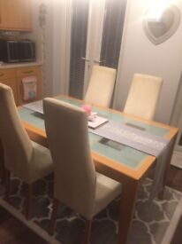 Glass Table Extendale And 4 Cream Faux Leather Chairs