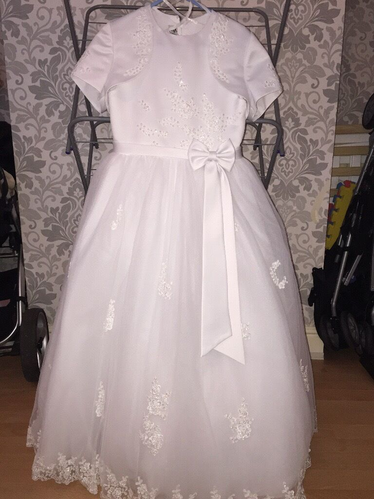 Communion dressin Prescot, MerseysideGumtree - Little people communion dress with underskirt, bolero, tiara and veil, paid just under £400 from scamps, selling for £100 for quick sale, been professionally dry cleaned. Excellent condition size 46
