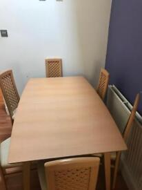 Extending dinner table with 6 chairs , great condition smoke free house